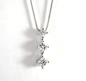 Three square cut diamonds white gold pendant