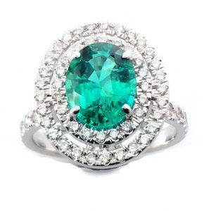 Emerald with double halo diamonds ring