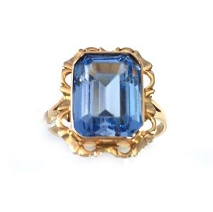 Blue stone solitaire ring