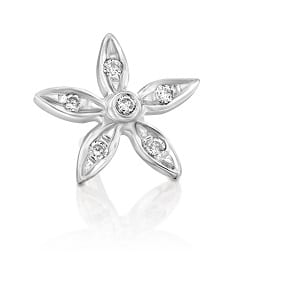 Diamonds flower earring piercing